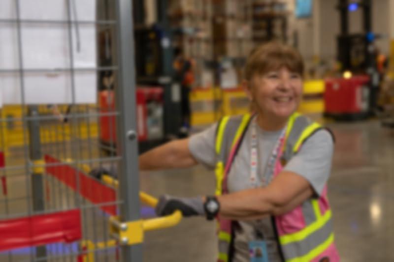 Woman Pushing a cart