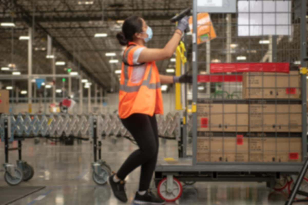 Amazon associate scanning products in the warehouse