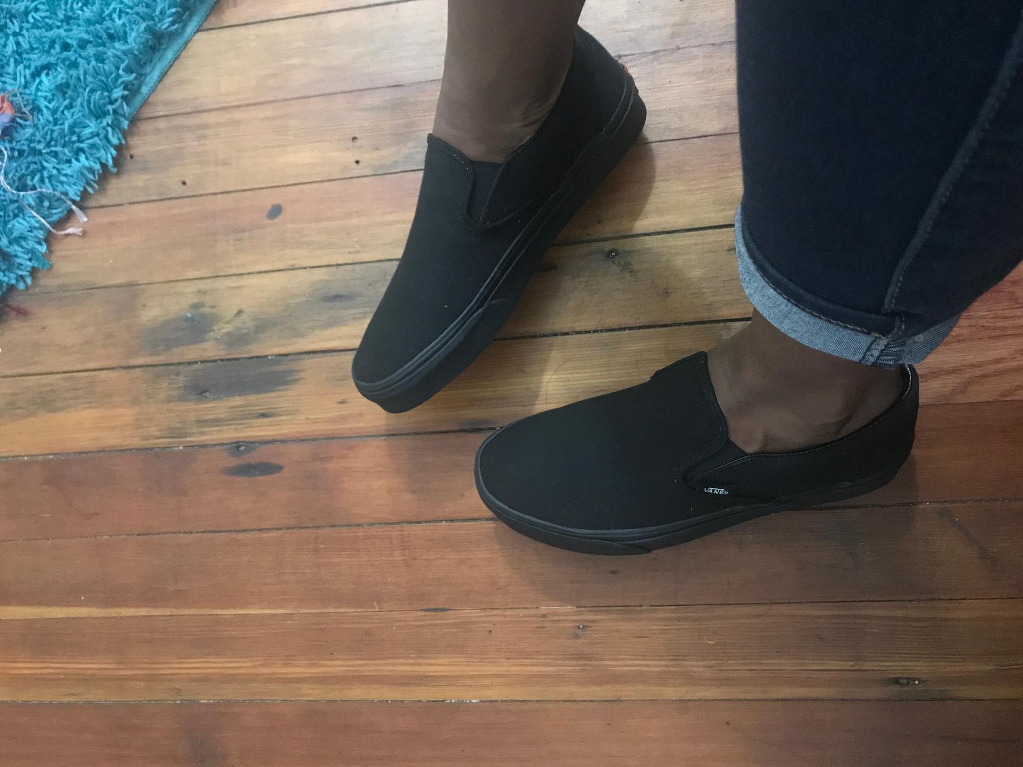 vans slip on black on feet