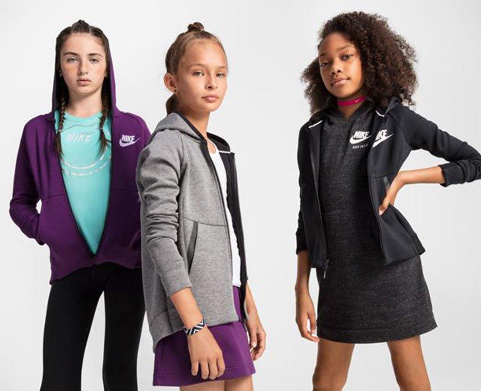 Image of girls wearing warm Nike clothing