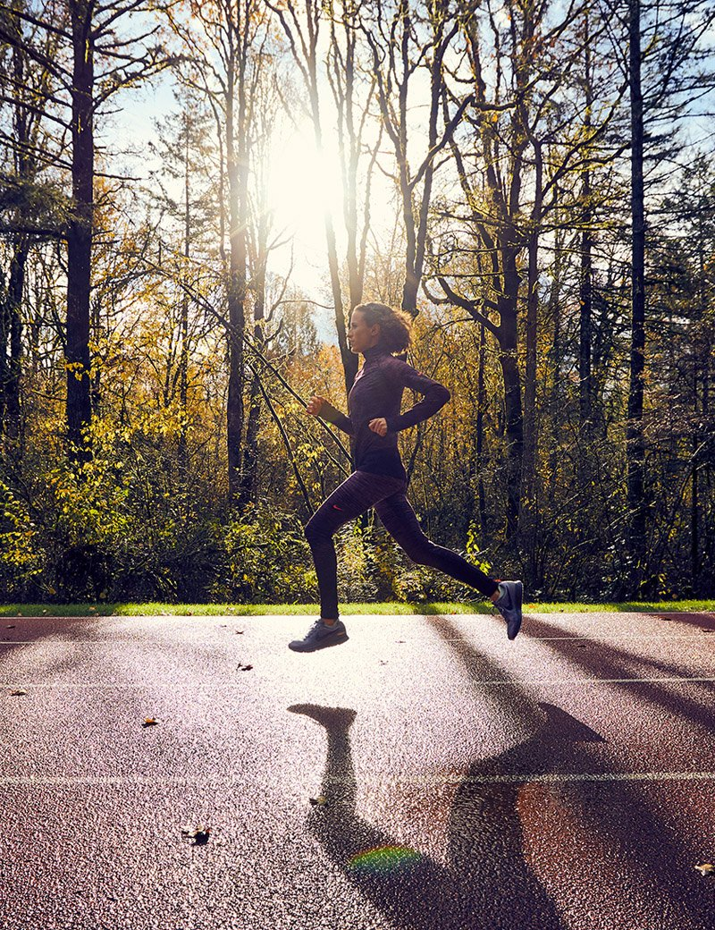 Image of Amy Cragg running in the woods.