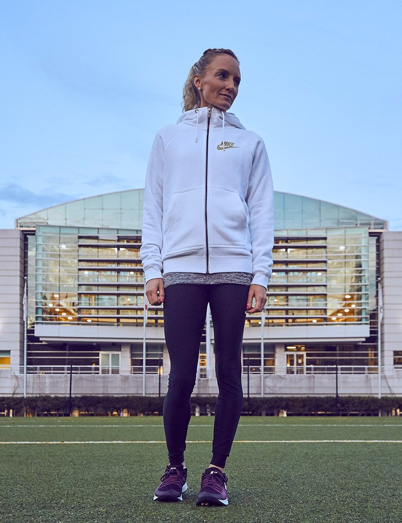 Picture of Shalane Flanagan standing in front of Nike HQ.