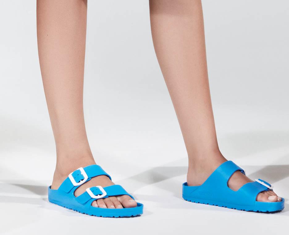 Image of woman wearing birkenstock shoes.