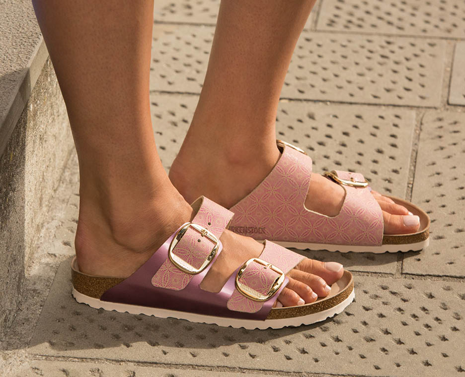 Image of woman wearing birkenstock shoes.