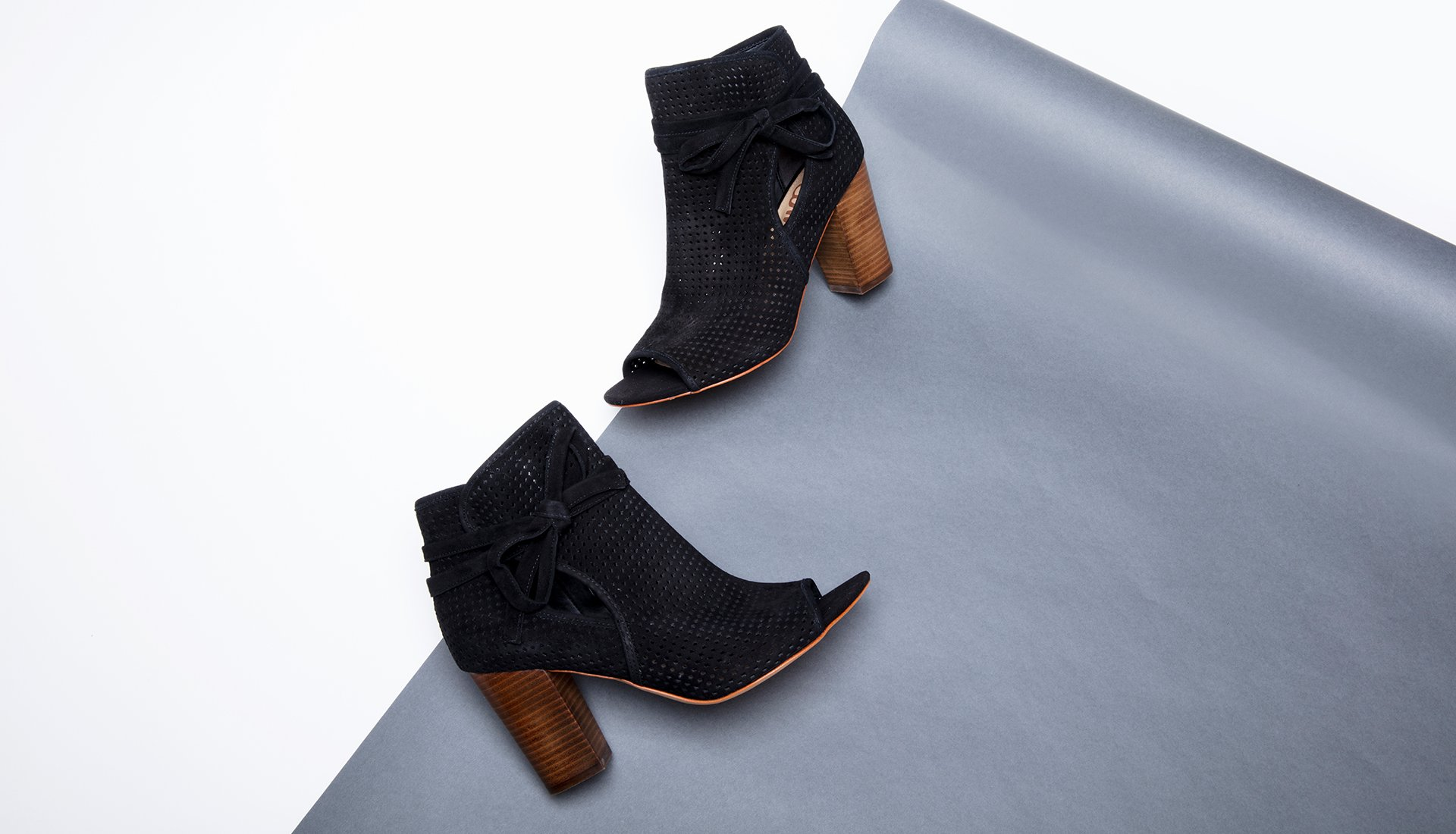 Image of open toe suede black ankle boots.