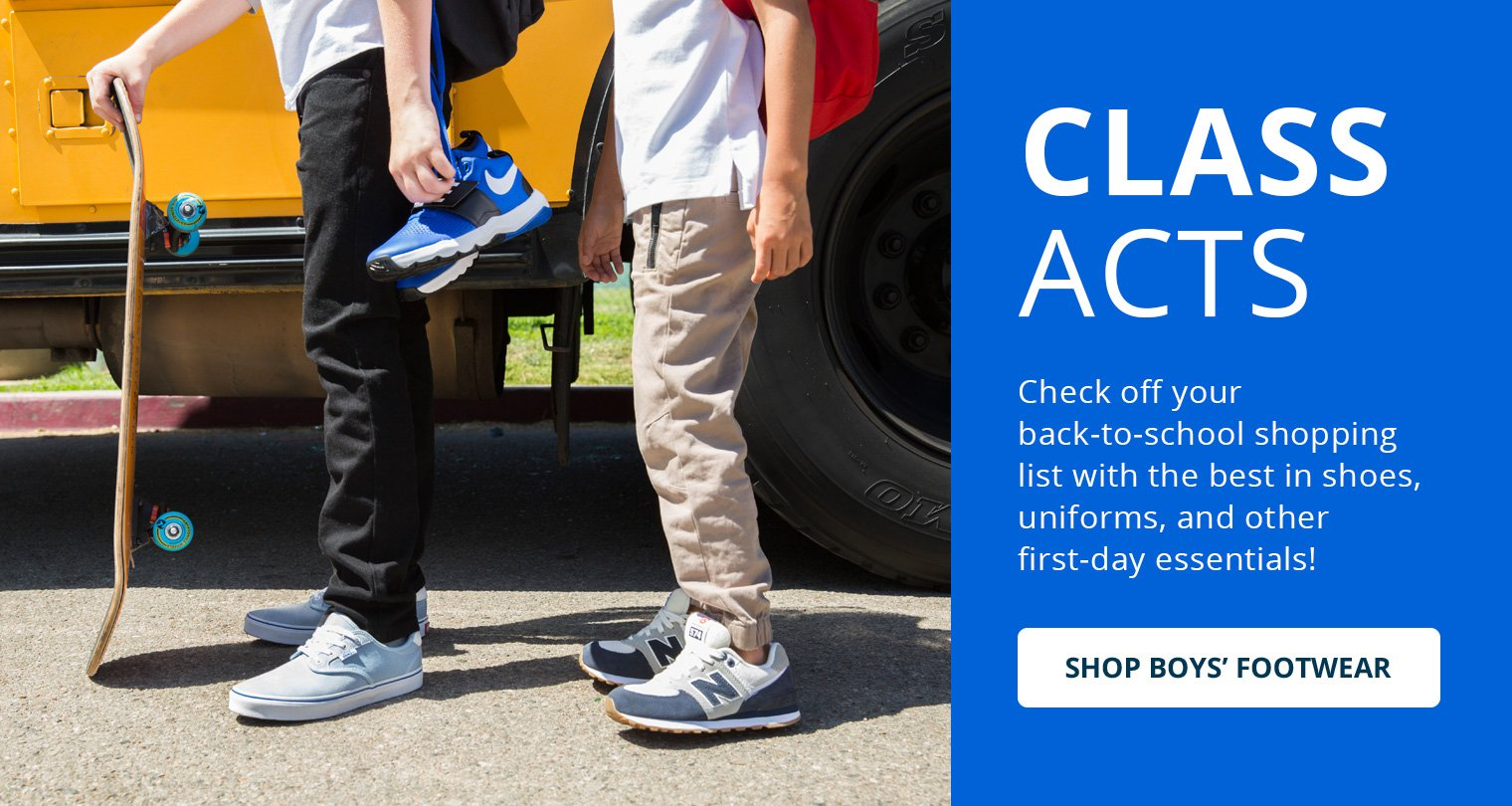image of boys shoes standing on a bus step