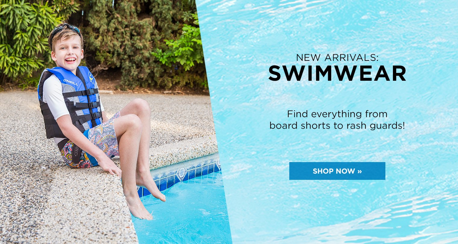 Shop Boys New Arrivals Swimwear Image of Boy sitting on edge of a pool