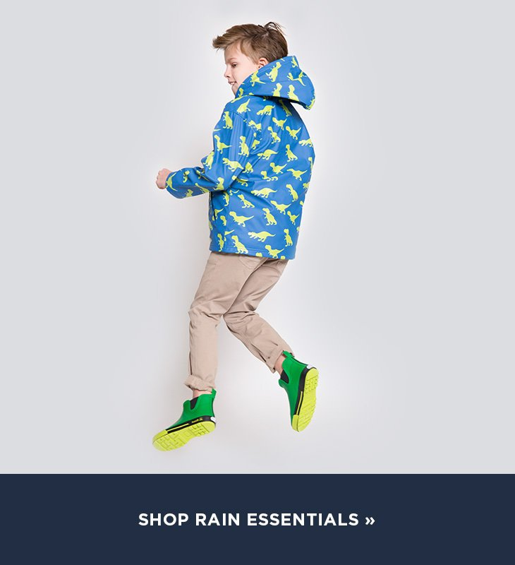 Image of boy jumping wearing a rain suit