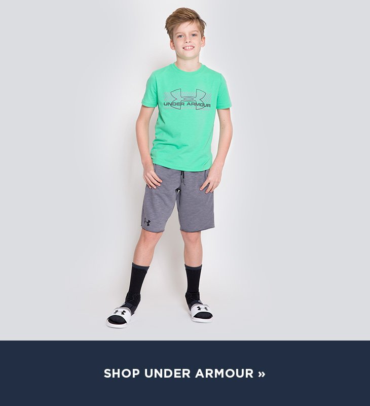 Image of a casually dressed boy wearing Under Armour