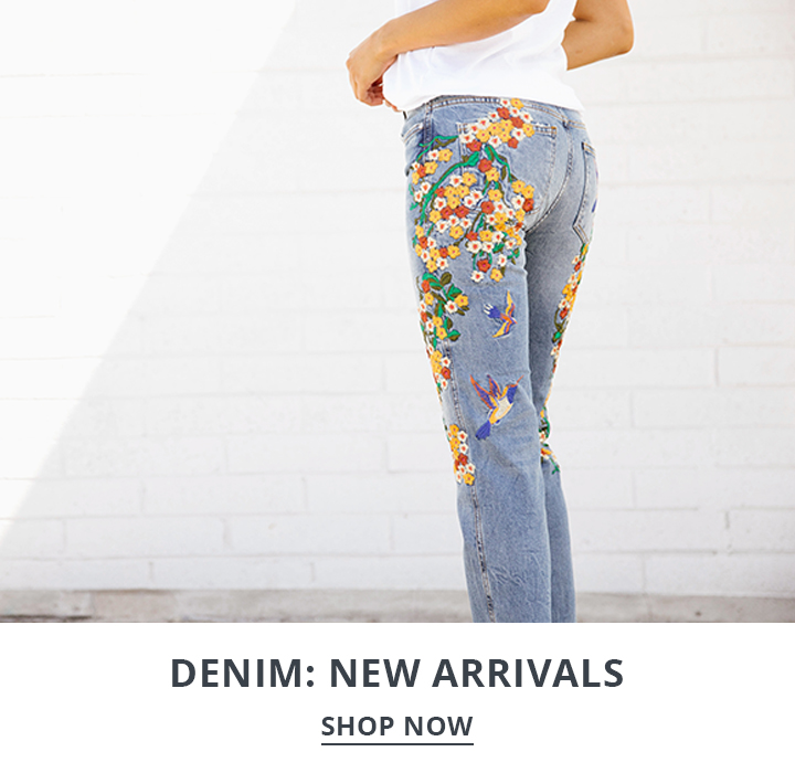 Image of a woman wearing floral print jeans.