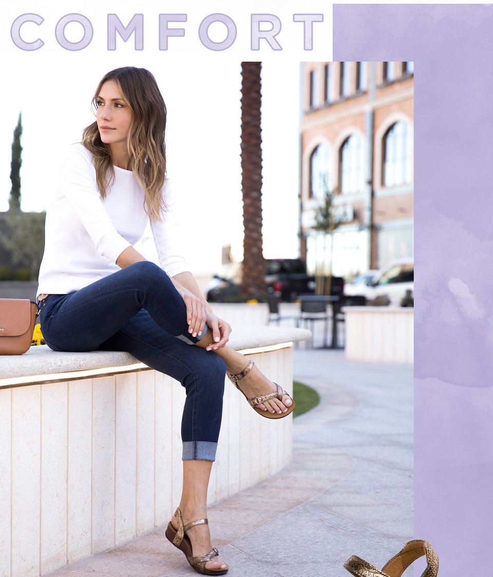 Comfort. Image of a woman in a cropped dark jean and white 3/4 sleeved top wearing a strappy metallic platform sandal.