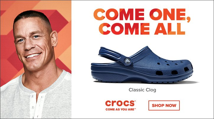 Image of a man next to a croc shoe.
