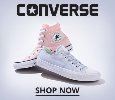 Converse. Image of a pink Converse hi-top and gray Converse low top. Shop Now.