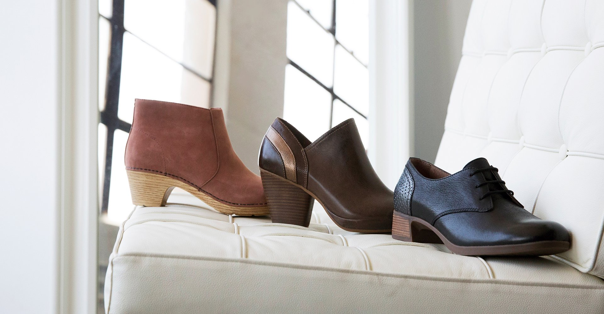 Image of three Dansko shoes. A bootie, an oxford and and ankle boot.