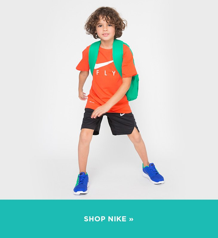 Image of Boys wearing Nike clothing and shoes