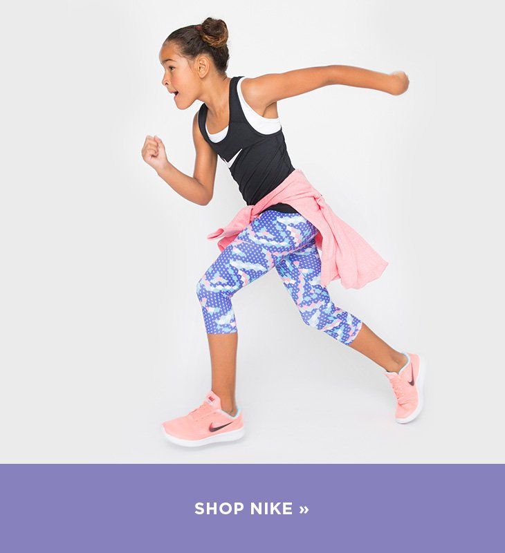 Image of girl wearing Nike clothing and shoes