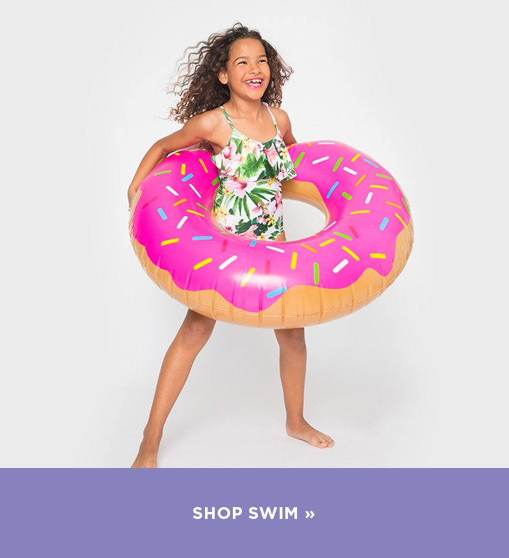 Image of girl in a swimsuit with a pool float