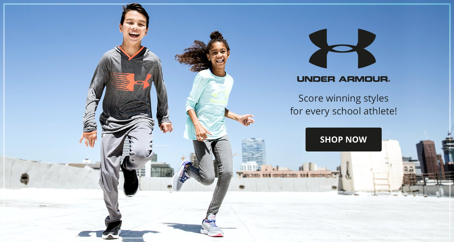Image of a boy and girl running outside wearing Under Armour.