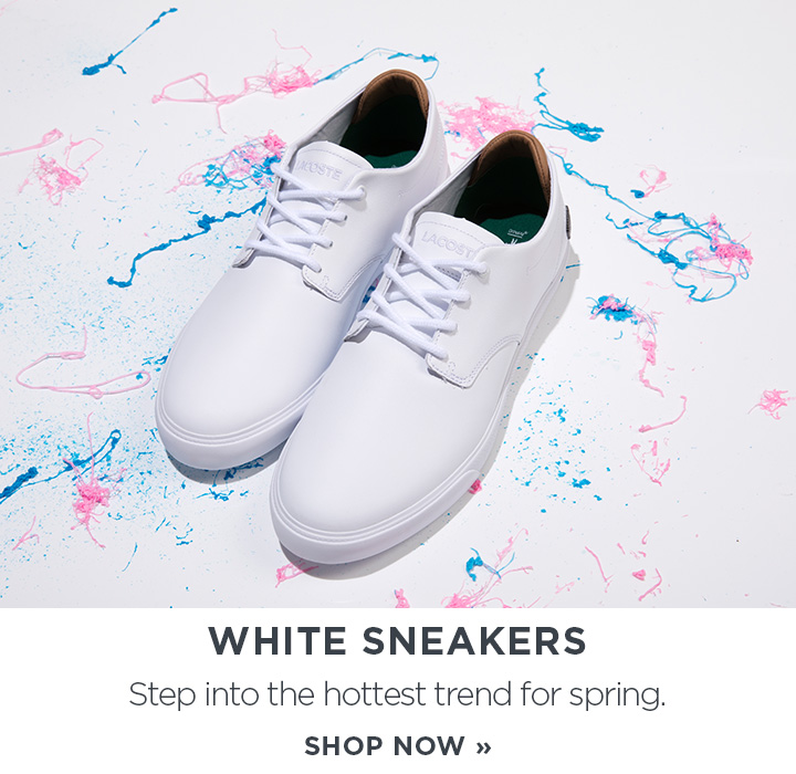 Image of a white sneaker with pain splatter in the background