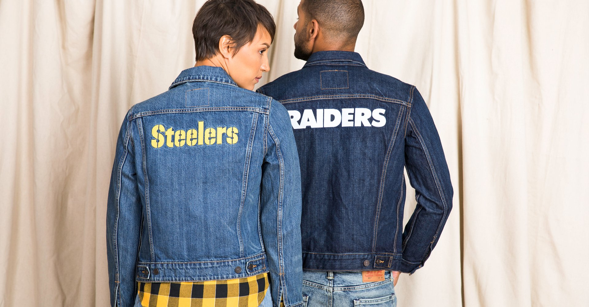 Image of a Man and a Woman wearing NFL Levi's Jackets.