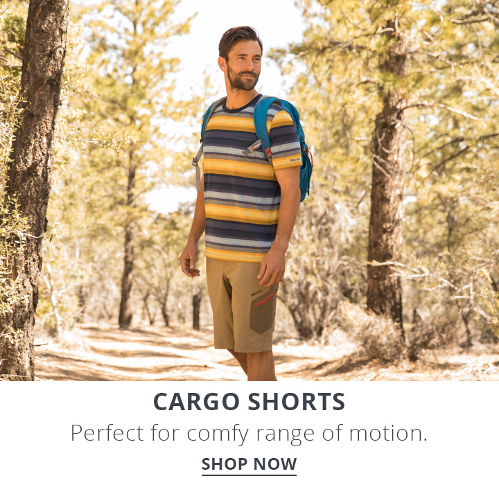 Image of man hiking in the woods wearing cargo shorts