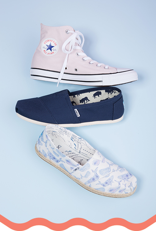Light pink converse high top sneaker, navy blue classic TOMS slip on shoe.