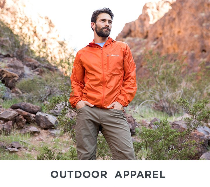 Image of a Man in outdoor apparel hiking.