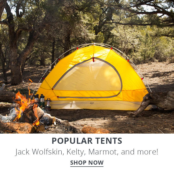 image of a campsite with yellow tent by a campfire