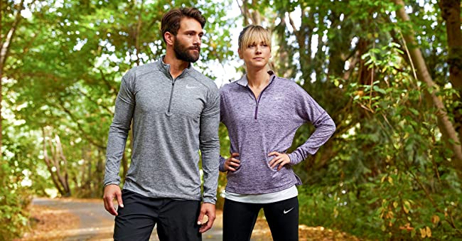 image of a man and a women wearing nike athletic clothing