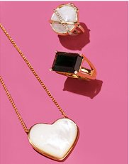 Jewelry. Image of a heart necklace and statement rings.