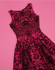 Date Night Dresses. Image of a red and black brocade dress.