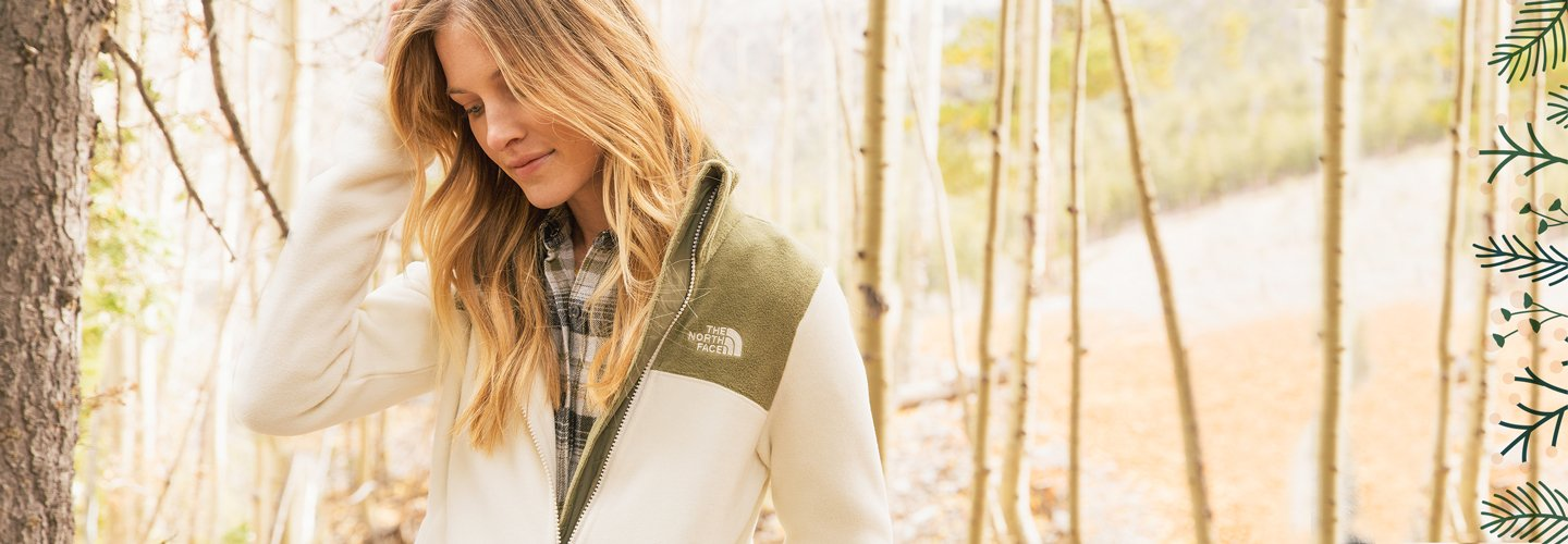 image of a woman in The North Face jacket. image links to assortment of  jackets.