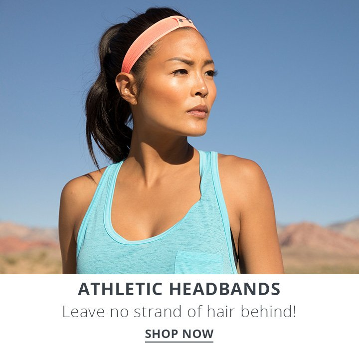 Image of a woman working out in the desert and wearing a headband.