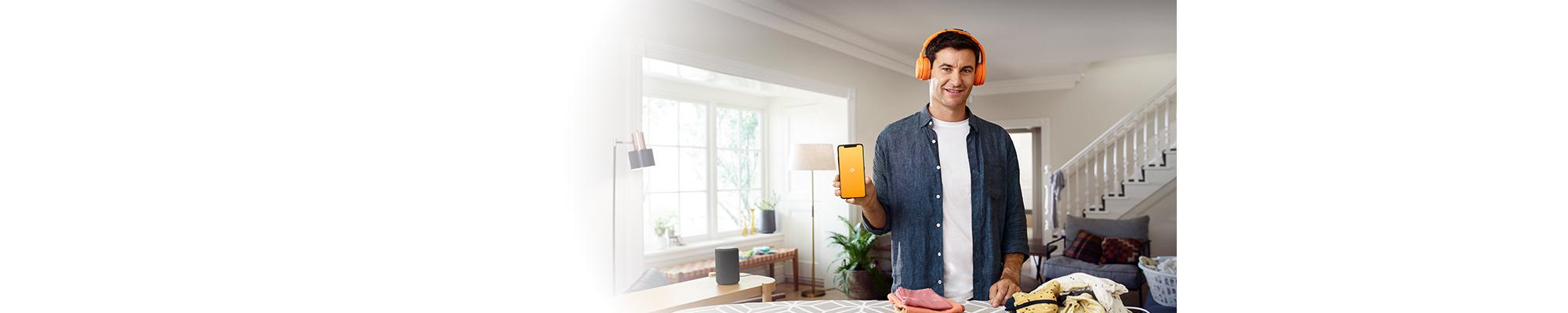 Clark Gayford holding up his Audible app, playing an audiobook