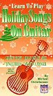 Learn to Play Holiday Songs on Guitar [VHS] [Import USA]