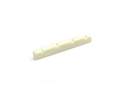 Knochen Sattel/Bone Nut Bass gekerbt Nr.29 Maße: 42mm Breite x 3mm Fussbreite x 6mm Höhe