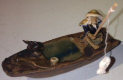 Bonsai Boy's Ceramic Figurine Fisherman On A Boat Fishing With Duck