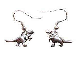 Pendientes o collares de plata con diseno de dinosaurio.
