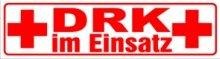 INDIGOS UG - Magnetschild DRK im Einsatz 45 x 12 cm reflektierend - Magnetfolie für Auto/LKW/Truck/Baustelle/Firma