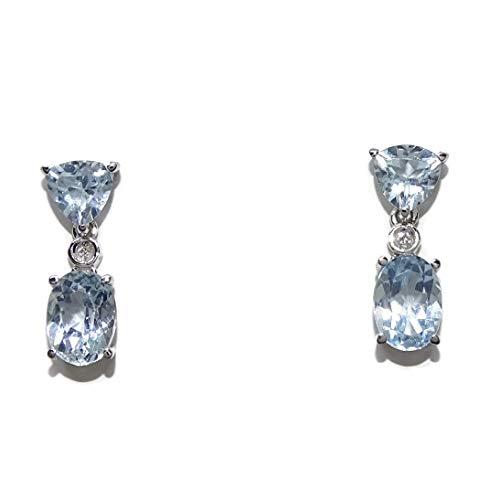Pendientes con topacio azul sky y diamantes en oro blanco de 18k. Cierre presión. 1.50cm de largos