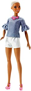 Play with style and play out stories with Barbie Fashionistas dolls, who wear unique outfits with fun details to inspire creative exploration and personal expression. Barbie doll shows her style wearing a chambray top with ruffled sleeves and white s...