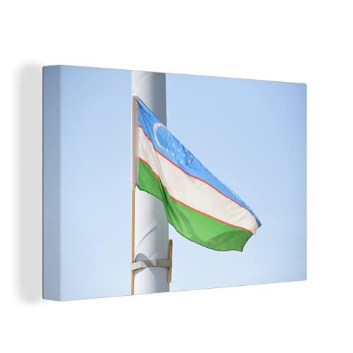 Leinwandbild - Hissende Flagge von Usbekistan - 150x100 cm