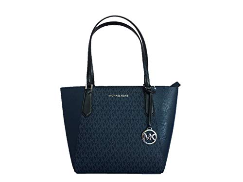 """MK signature coated twill PVC with leather trim and silver-tone hardware. Top-zip closure. Polished MK logo lettering across the front and logo charm hangtag. Double shoulder strap with 9.5"""" drop. Interior: Unlined; one multifunction slip pocket. App..."""