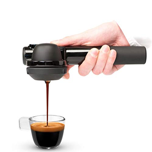 a person using the handpresso wild hybrid to make a cup of coffee