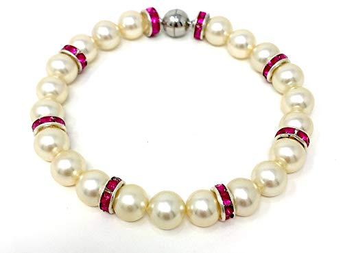 Pulsera hecha de auténticas perlas blancas de Mallorca y anillos de metal con piedras preciosas de color rosa