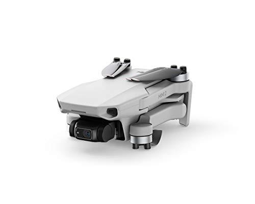 DJI Mini 2 Combo - Drone leggero e pieghevole, Gimbal a 3 assi con fotocamera 4K, Foto da 12 MP, 3 batterie, Centro di ricarica, Trasmissione video HD OcuSync 2.0, Cardless, Senza Care Refresh