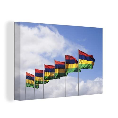 Leinwandbild - Die Flaggen von Mauritius im blauen Himmel - 150x100 cm