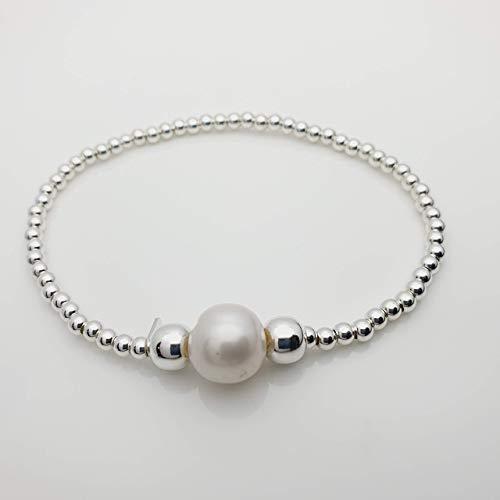 Rosario García Diseño en Plata, Pulsera elástica con cuentas de plata y perla natural cultivada en agua de mar, detalle y regalo ideal, joyería discreta y elegante