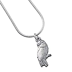 Harry Potter's Owl Necklace - Silver Plated Hedwig measures approx. 1.5cm (W) x 3cm (H) Comes on a 40cm Silver-Plated Snake chain with 6cm extender Presented on Harry Potter branded backing card 100% officially licensed Warner Bros. Harry Potter merc...