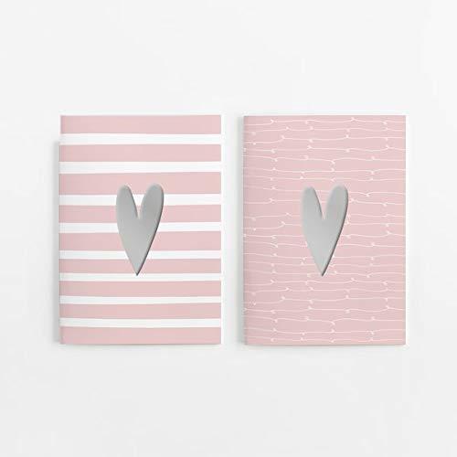 2er Set Notizheft DIN A5 (blanko) in rosa mit 2 verschiedenen Herz-Motiven und jeweils 40 Seiten in weiß mit 120 g Papier. Vorderseite mit hochwertiger Silberfolien-Veredelung.